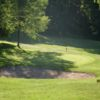 A view of a green protected by a sand trap at Oak Lake Golf Course